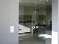 Drzwi przesuwne dwuskrzydłowe. Szkło antisol grafit.